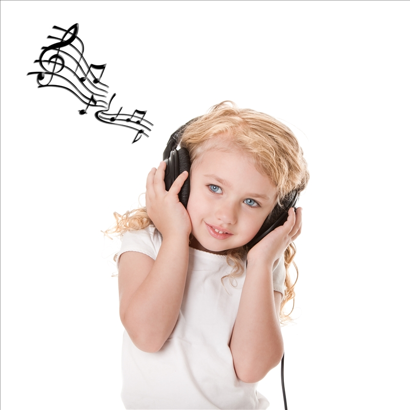 Beautiful cute happy blond girl with headphones grooving having fun listening to music, isolated.